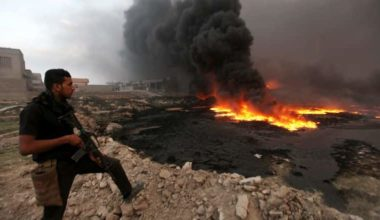 Oil Fires Cast Black Cloud Over Iraqi Town